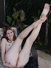 Redhead with see-through pink panties gets completely naked outdoors